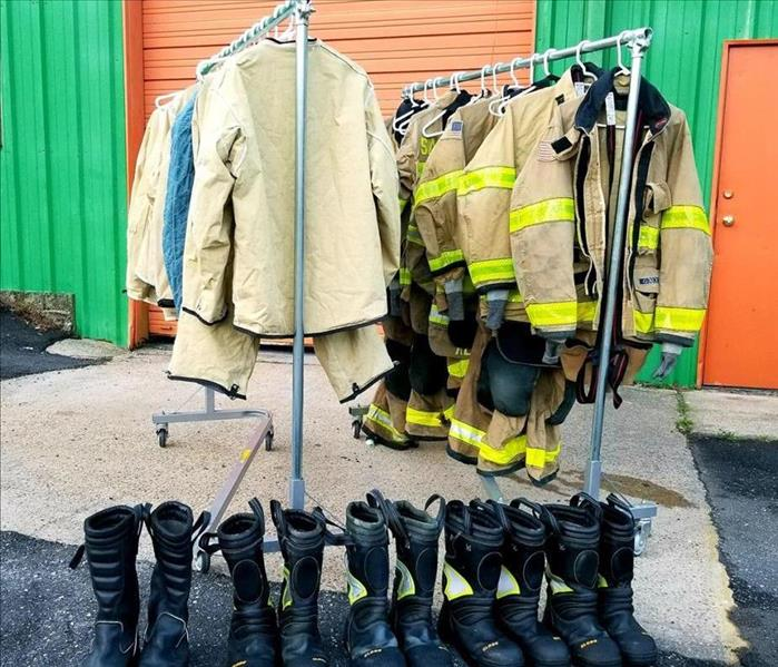 firefighters equipment hanging on racks