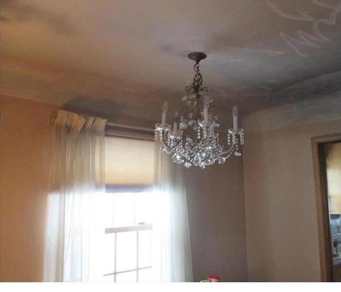 chandalier on soot covered ceiling