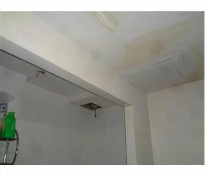 white ceiling with brown water stains