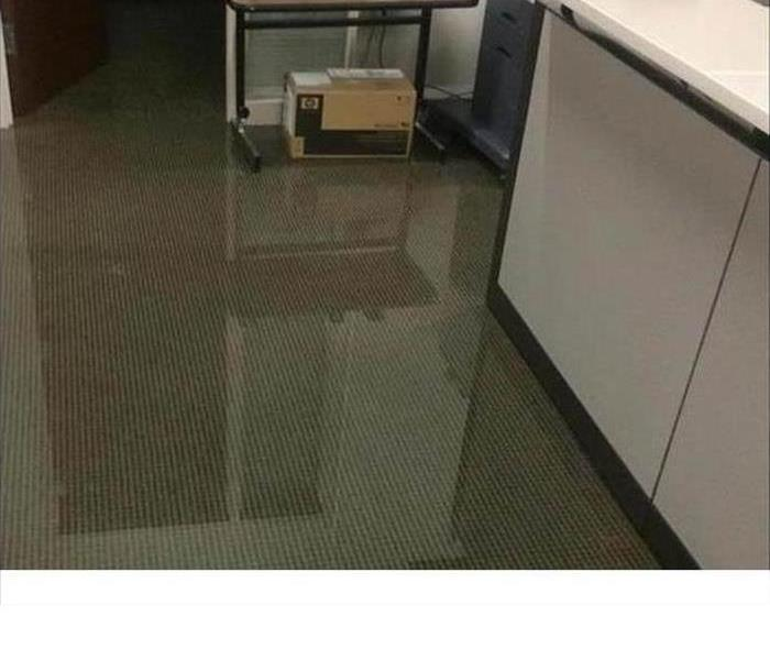 commercial office workspace with standing water