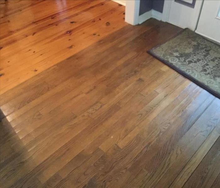 hardwood floor laying flat after being dried following water damage