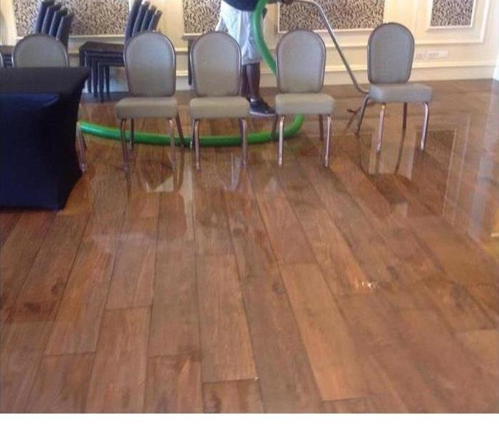 hardwood floor with standing water
