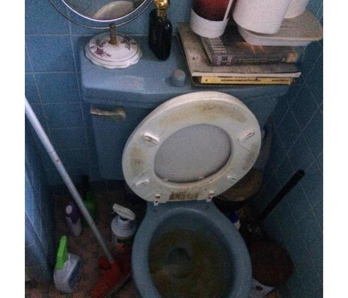 Toilet with soot damage