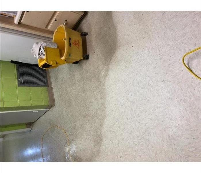 dirty floor with mop bucket
