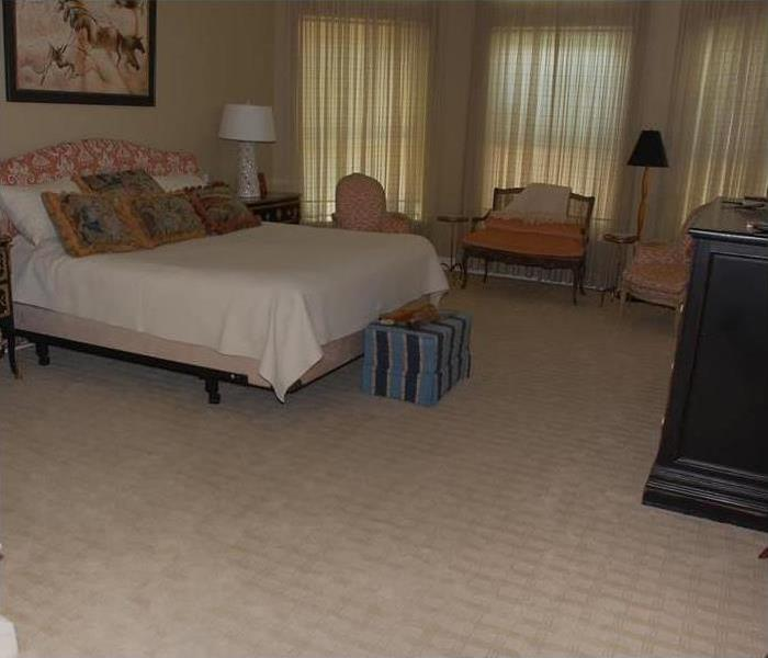 Light tan colored carpeting in bedroom that is dry and clean