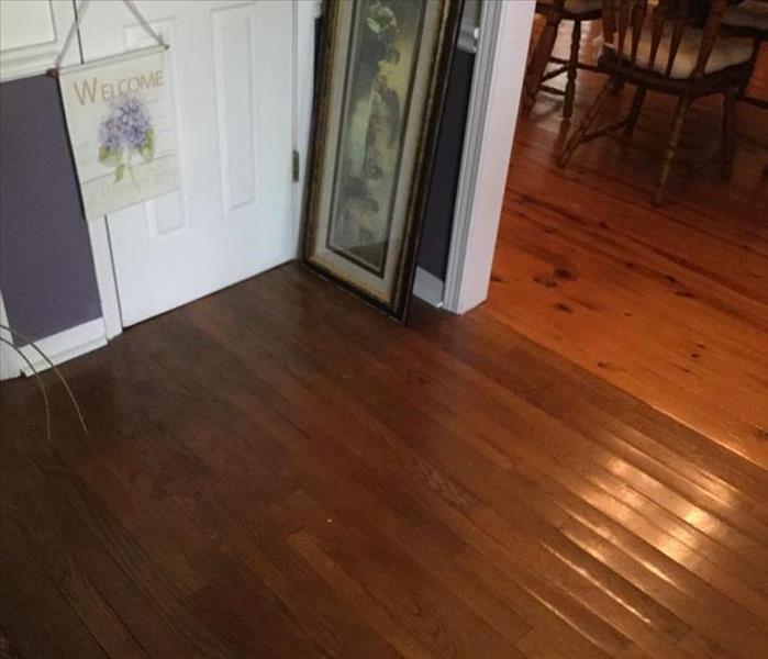 hardwood floor with cupping from water damage