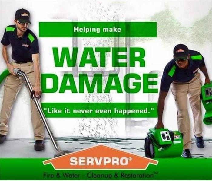 2 SERVPRO technicians green words say water damage