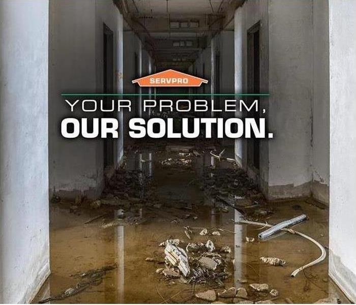 Picture of water damage with SERVPRO orange house logo