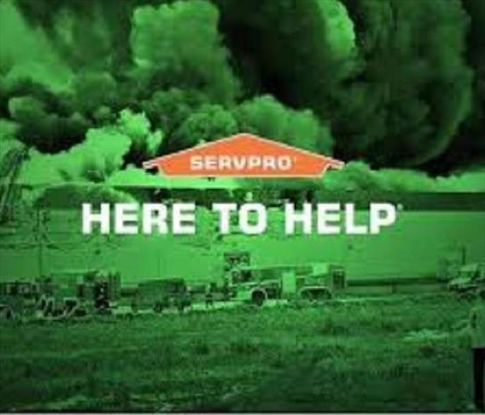 green photo with storm clouds and SERVPRO logo/words here to help