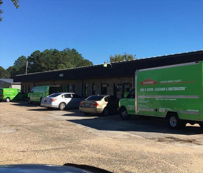 building with SERVPRO van in front