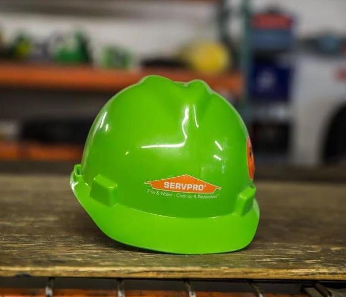 lime green hardhat on table